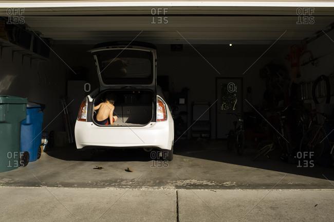 Boy in a trunk of a car
