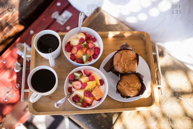 Breakfast and black coffee in tray during safari vacation