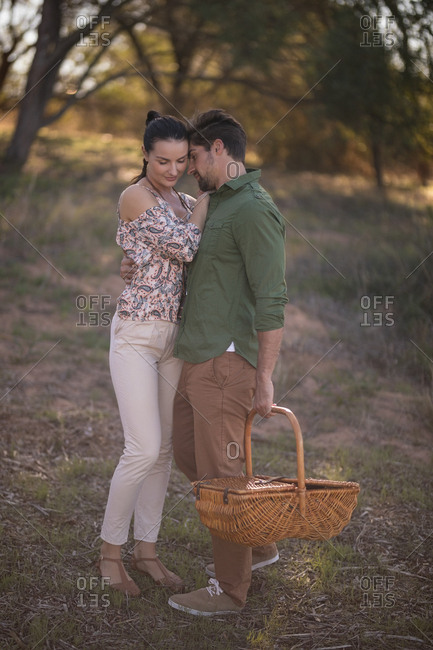Romantic couple embracing each other during safari vacation