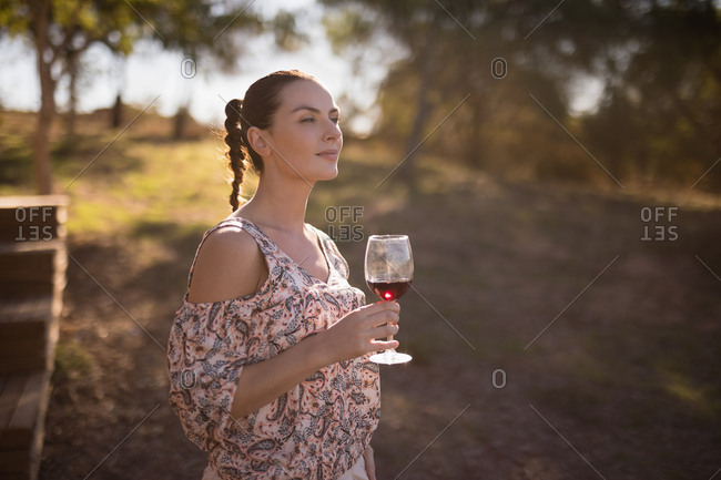 Thoughtful woman having a glass of wine during safari vacation