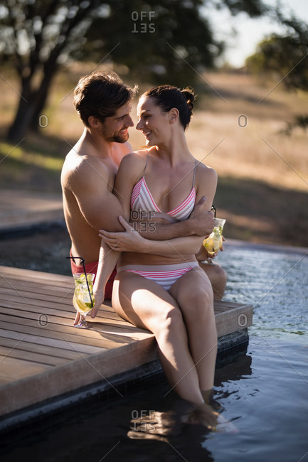 Happy couple relaxing in pool during safari vacation