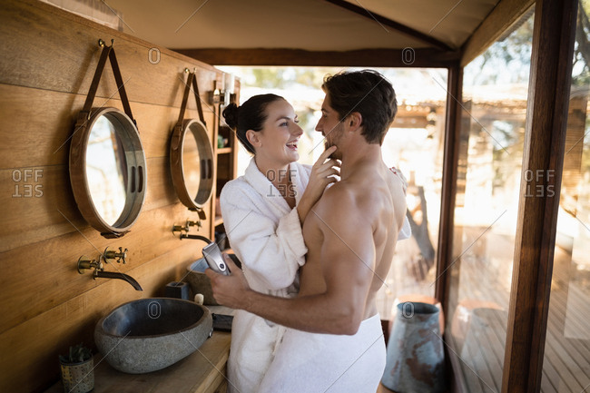 Couple having fun together in cottage during safari vacation