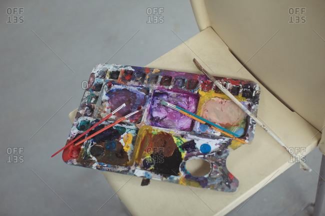 Paintbrushes on palette in art studio