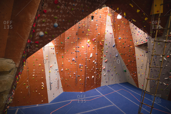 High angle view of climbing wall in fitness club
