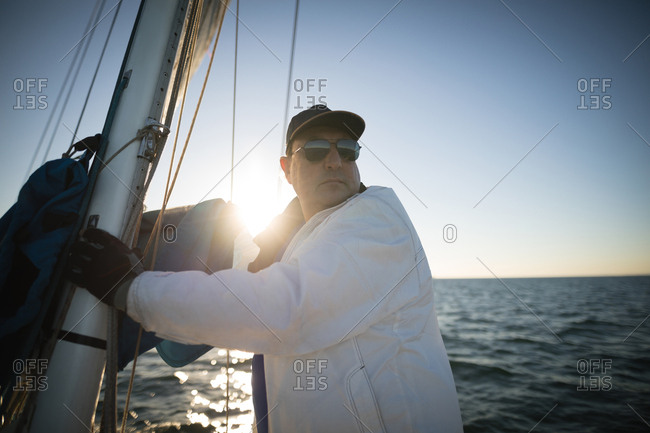 Yachtsman standing on the boat on a sunny day