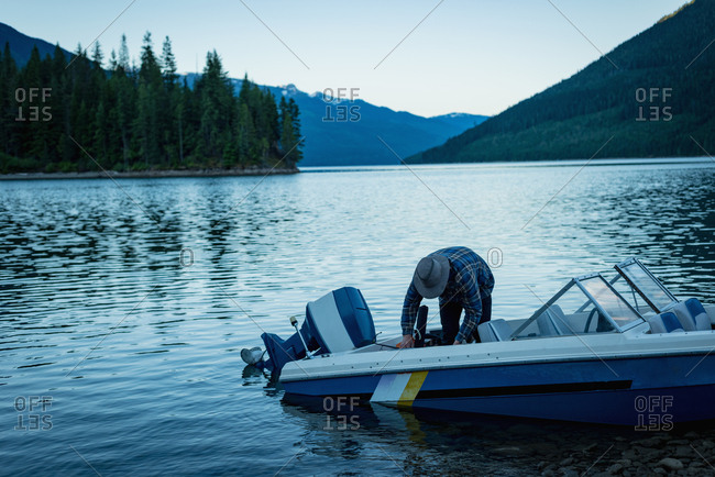 Man standing in boat on river