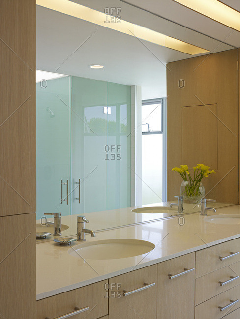 Interior view of residential building in Los Angeles, California, USA, double wash basins with mirror