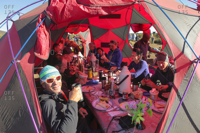 August 25, 2013: A Guide Enjoying A Coffee While Having Breakfast Inside A Tent In A Camp At Mount Kilimanjaro