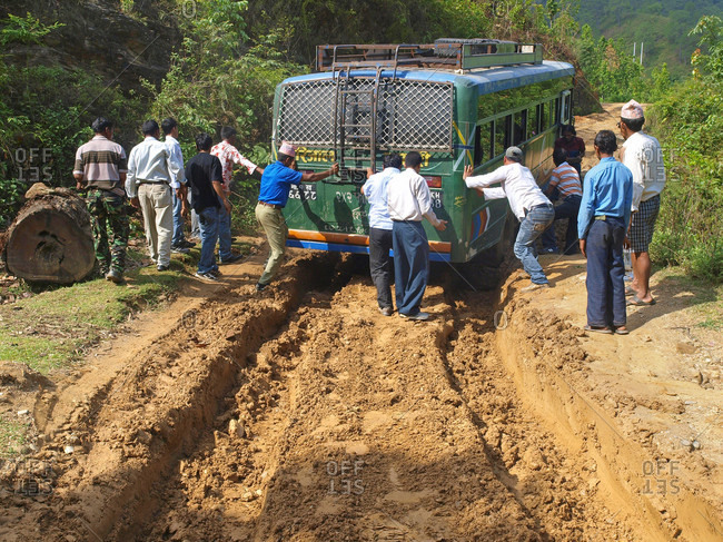 May 24, 2008: Nepalese People Pushing A Bus That Became Stuck In The Mud, Manaslu Region, Nepal