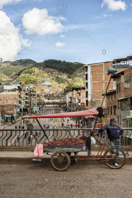 February 25, 2014: A Vendor Standing On Street In Cusco City, Peru