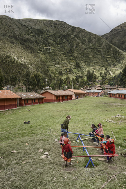 March 21, 2014: Children Playing In An Elementary School's Yard Against The Sacred Valley, Urubamba Valley, Peru