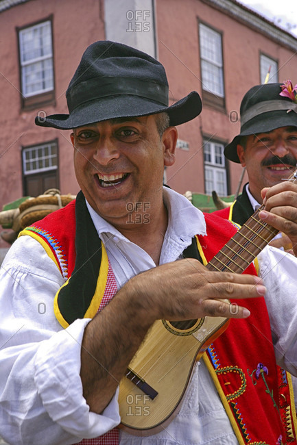 May 29, 2015: Portrait Of A Smiling Man In A Traditional Attire Playing Ukulele, Santa Cruz De Tenerife City, Spain