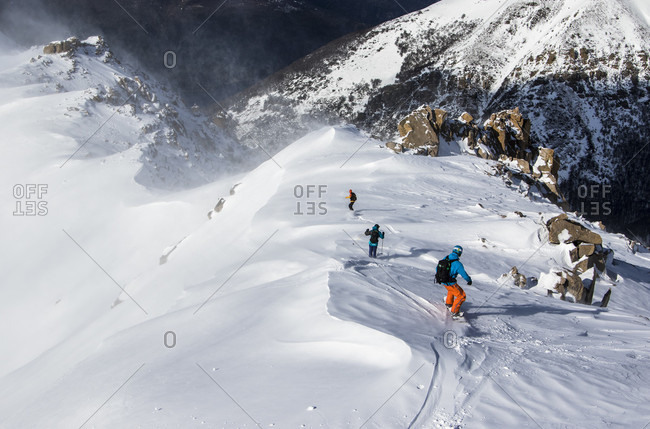 August 11, 2015: Three Backcountry Skiers And Snowboarders Ride Down A Ridgeline To Gain Access To The Area They Are Trying To Ride In The Backcountry Surrounding Cerro Cathedral In Argentina