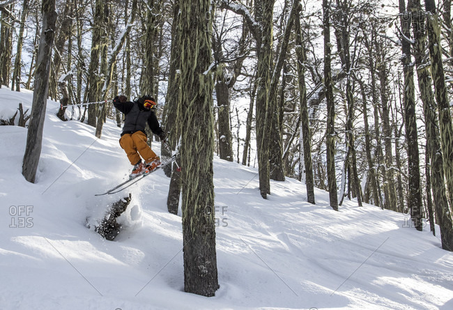 August 14, 2015: A Skier Airs Off A Snow Covered Stump And Taps A Tree With His Tails In A Forest Around Cerro Cathedral In Argentina