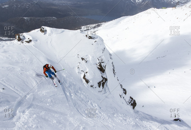 August 26, 2015: A Man Skis A Skinny Chute With Partially Tracked Snow On A Sunny Day In Bounds At Cerro Cathedral In Argentina
