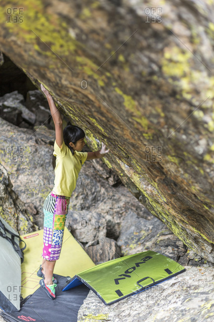 August 22, 2013: Ashman Shiraishi gets ready for a boulder problem in Rocky Mountain National Park, Colorado