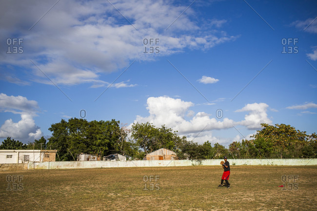 September 12, 2017: A Single Baseball Player Practices In A Field, Dominican Republic