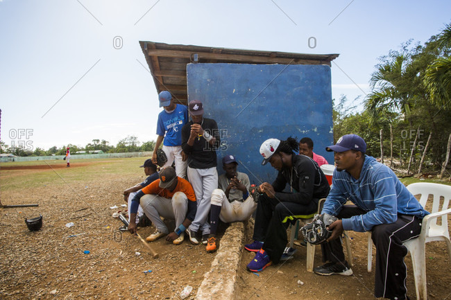 September 12, 2017: Young Baseball Players Sitting Outside The Dugout At A Sandlot Field In The Dominican Republic