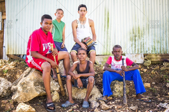 September 12, 2017: Five Teenage Boys With Baseball Bats Sit On Rocks, Santo Domingo, Dominican Republic