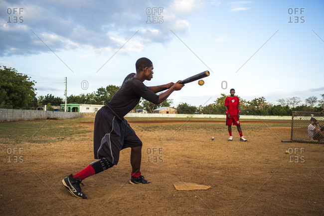 September 12, 2017: A Baseball Player In Sports Clothing Prepares To Hit A Ball Thrown By A Pitcher On A Dirt Field, Santo Domingo, Dominican Republic