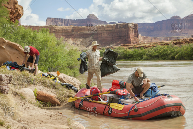 May 19, 2015: Men pack their raft on the Green River below Turks Head, Canyonlands National Park, Utah.