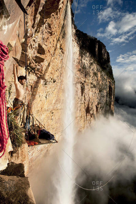 February 5, 2012: Man Stretching His Hand Standing On The Portaledge Near The Angel Waterfall, Bolivar State, Venezuela