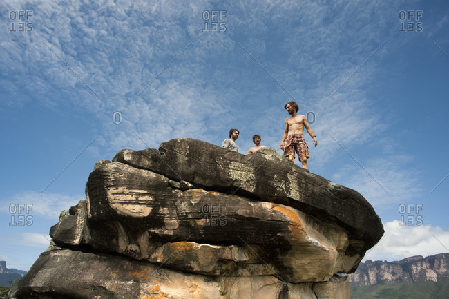 February 5, 2012: Group Of Men Standing On Top Of The Boulder, Bolivar State, Venezuela