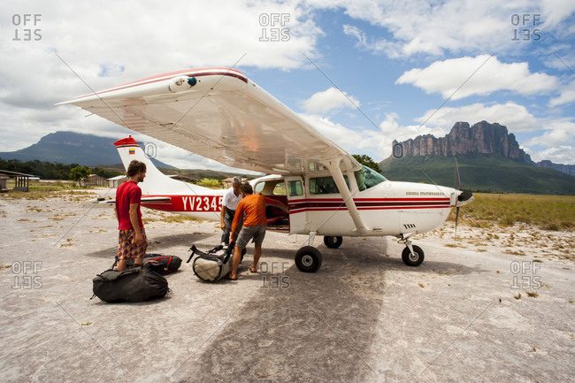 February 5, 2012: Group Of Men Loading Their Backpack In Airplane, Bolivar State, Venezuela
