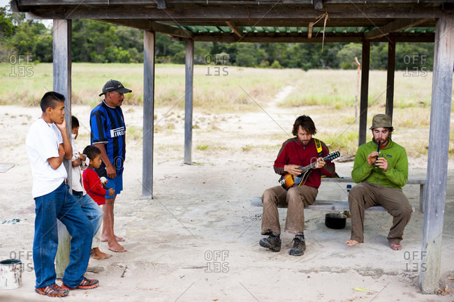 February 5, 2012: Village People Looking At Two Man Playing Music, Bolivar State, Venezuela