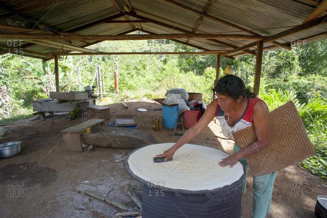 February 5, 2012: Woman Cooking Flour Of Cassava At Outdoors, Bolivar State, Venezuela