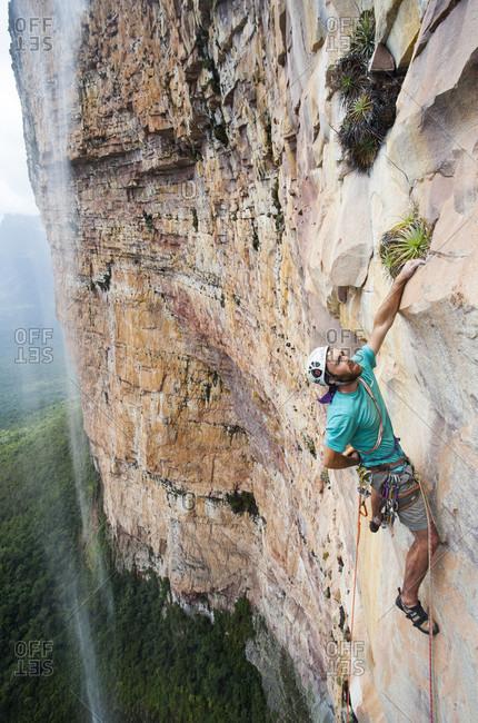 February 5, 2012: Man Rock Climbing Near Waterfall, Bolivar State, Venezuela