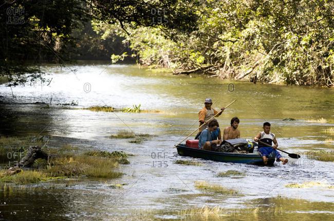 February 5, 2012: Group Of Men Traveling By Boat On River, Bolivar State, Venezuela
