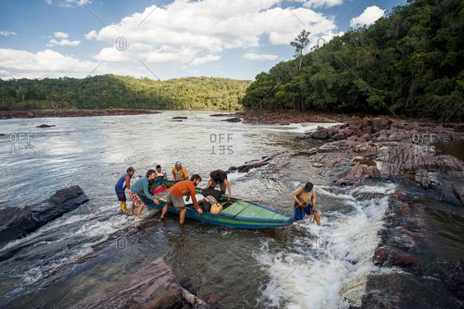 February 5, 2012: Men Pulling Boat Put Of The River, Bolivar State, Venezuela