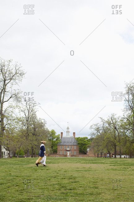 Williamsburg, Virginia - April 14, 2010: Woman in costume by Governor's Palace