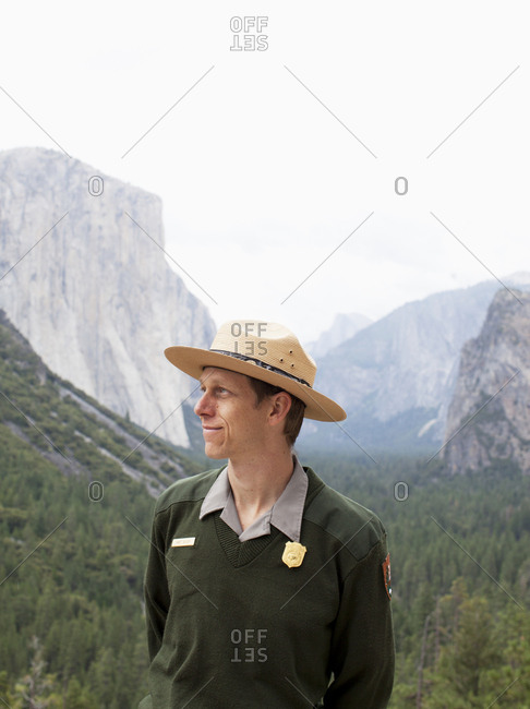 Yosemite, California - September 8, 2010: Forest ranger with scenic view