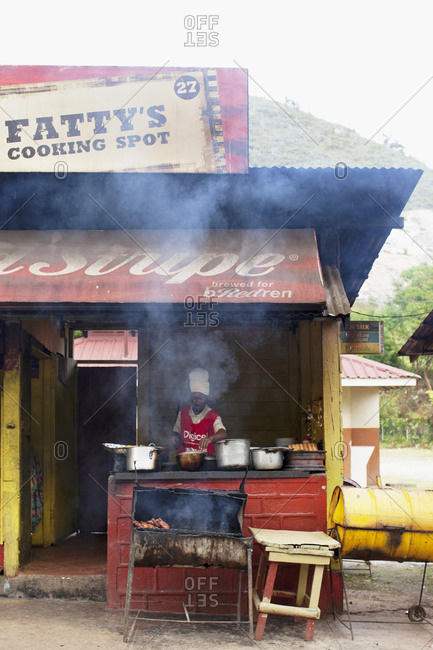 Faith Pens, Jamaica - December 1, 2010: Man cooking at food stall
