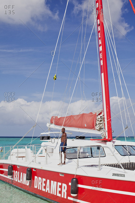 Montego Bay, jamaica - November 29, 2010: Man on a sailboat