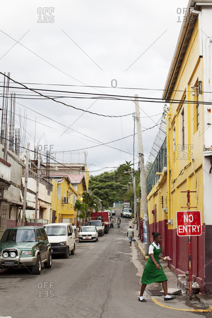 St Thomas, jamaica - December 2, 2010: Woman in neighborhood street