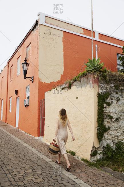 Woman walking in street in jumpsuit