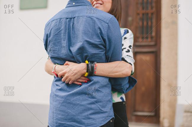 Couple hugging in street - Porto, Portugal