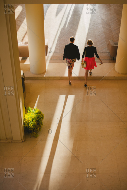 Female guests entering a wedding