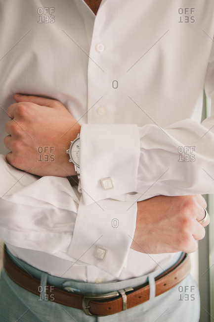 Groom showing off cufflinks
