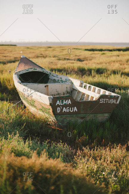 Comporta, Portugal - June 26, 2014: Weathered boat in coastal plants