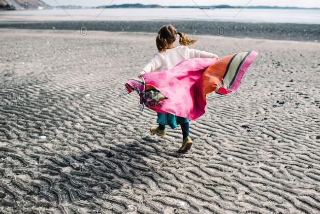 Girl with cloth in coastal wind