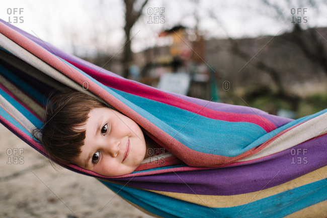 Girl wrapped in a hammock