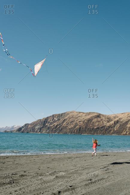 Girl with kite on a beach