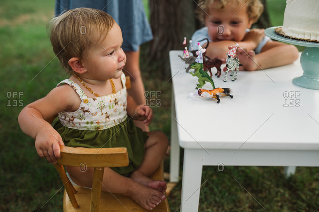 Girl sitting by toys on table