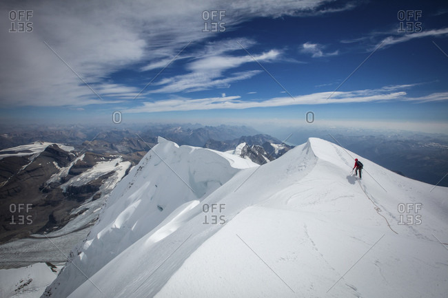 Photograph of mountain climber climbing at Mount Robson in winter, British Columbia, Canada