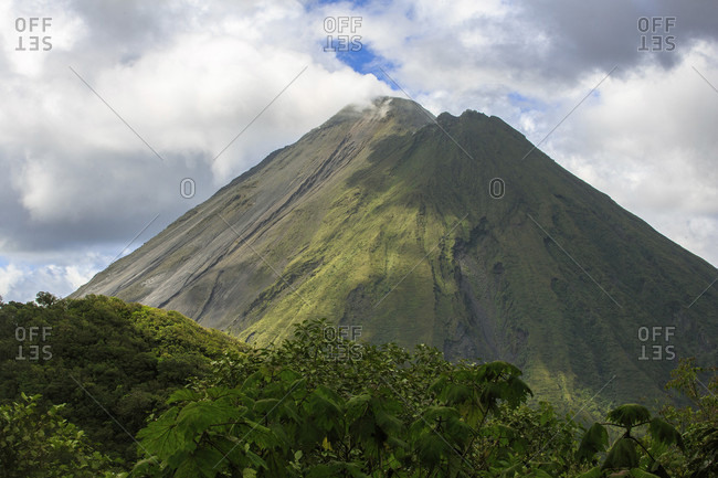 Arenal Volcano, an active volcano sits in the province of Alajuela, Canton of San Carlos, and district of La Fortuna, Costa Rica.