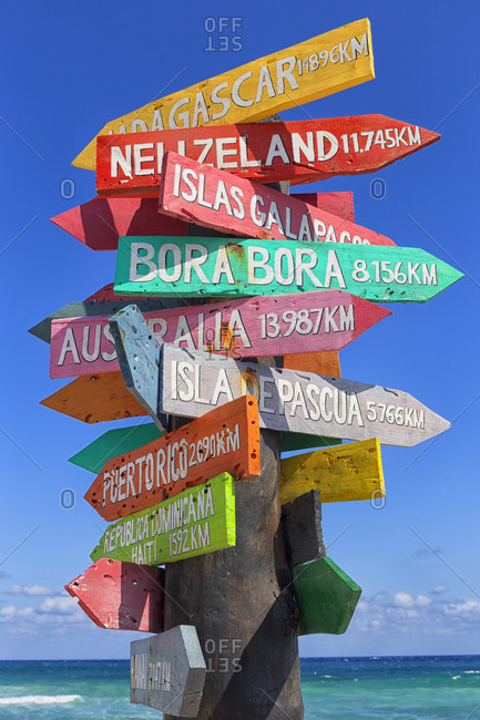Colorful directional sign with lots of directions, Punta Celarain, Punta Sur Ecological Reserve, Cozumel, Yucatan Peninsula, Mexico
